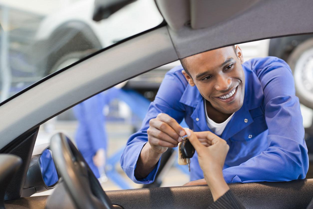 11Man handing keys through car window to driver