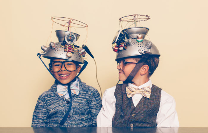 11Two Boys Dressed as Nerds Smiling with Mind Reading Helmets