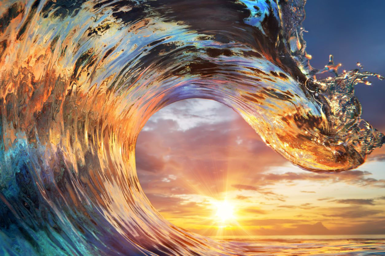 11Colourful ocean wave with sunset and clouds in background