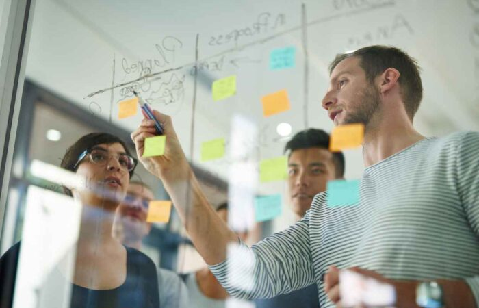 11Group of people working together at whiteboard